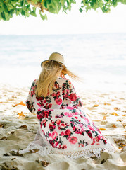 Woman in colorful beach garment