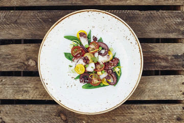 Octopus salad with seasonal tomatoes and green peas