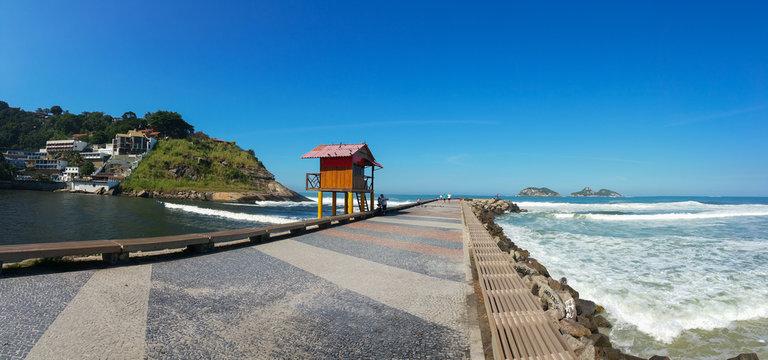Pier in Barra da Tijuca beach in Rio de Janeiro with lifeguard house