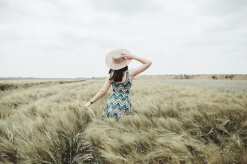 Happy young woman in a field. - Self portrait
