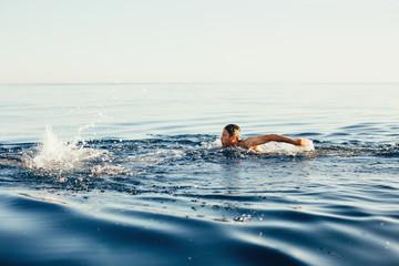 Swimming man in the ocean.