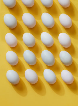 Eggs, neat eggs arranged on a yellow background