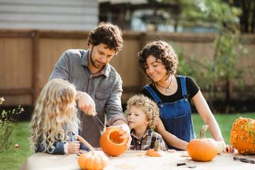 Family carving pumpkins together