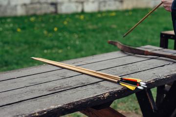 Arrows on a table at an arhery range