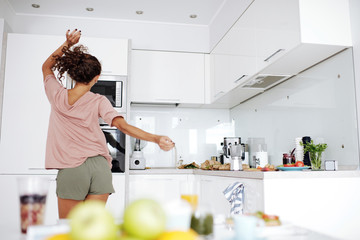 Woman dancing in the kitchen