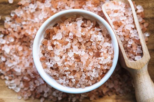Himalayan pink salt in wooden spoon