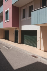 Shadows On The Street And Colorful Facade Of A Building