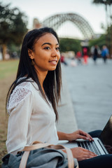 Young Woman Looks Around with Laptop