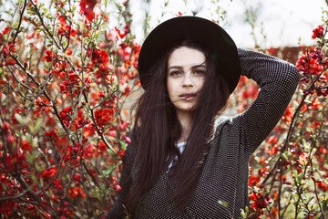 Portrait of a beautiful woman in the flowers