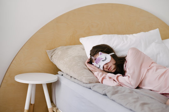 Young female model sleeping in bed morning
