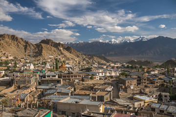 Aerial image of mountain city surrounded by Himalayan moun range