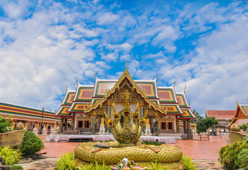 The sanctuary, temple, with the beautiful sky cloud.The public properties at Wat Phra That Choeng Chum,Sakon Nakhon Province, Thailand.
