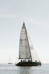 sailboat with crew members on board preparing for yacht race
