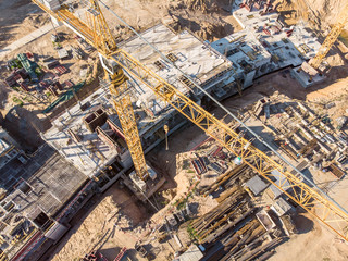 construction site with yellow building crane. housing development