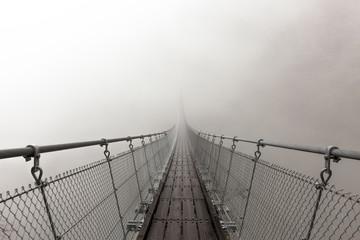 suspension bridge in mist