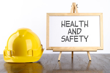 Safety helmet and white board with words Health and Safety,Health and Safety concept. Wall mural