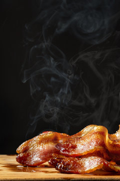 Hot Steaming Bacon on Black - Vertical