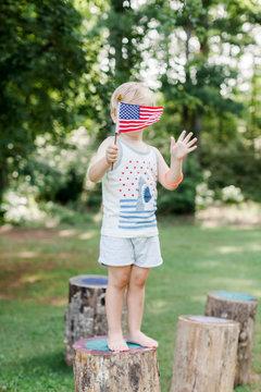 Child holding American flag