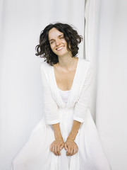 Laughing model in white