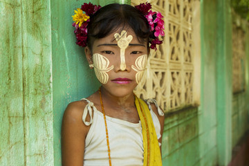 Young burmese girl with Tanaka on her face