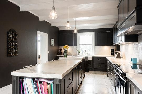 modern kitchen in dark grey with marble counters