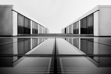 Abstract black and white glass building with balconies.