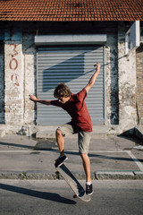 Teenager jumping with his skateboard