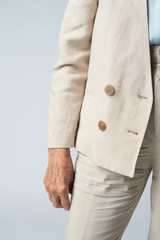 Stylish cream suit on senior woman