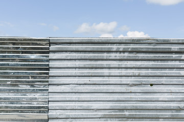 metal wall and blue sky