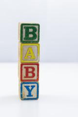 Children's toy blocks spelling the word Baby