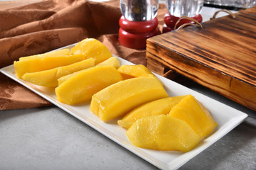 Juicy mango slices on a plate