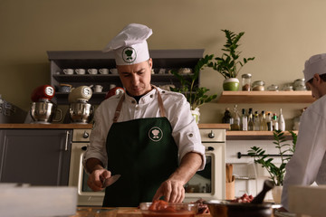 Cook making dish in restaurant