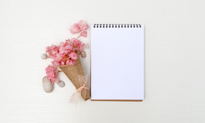 Notepad mockup with pink flowers, sketchbook, white background