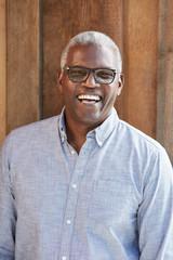 Closeup portrait of African American Senior man laughing