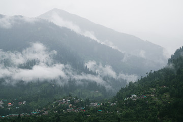 Village at the foot of the foggy cloudy Himalaya mountain