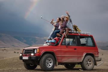 Travelers taking selfie on nature