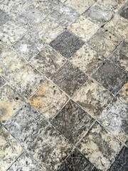 The texture of the stone pavement in the old town