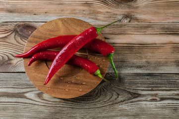Red hot chili pepper on a wooden background. Top view