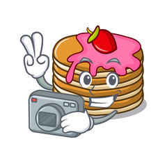 Photographer pancake with strawberry mascot cartoon