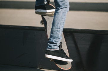young man doing trick on skateboard
