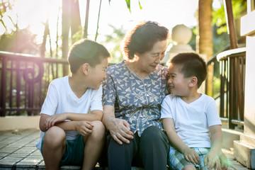 Happy Senior Asian Woman Talking With Her Grandchildren