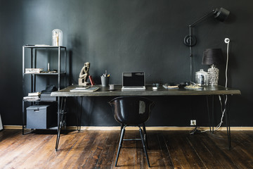 Dark home office with black walls