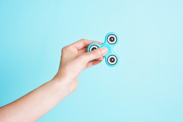Hand holding a Fidget spinner