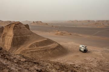 camping truck in rugged iranian desert landscape, kalut