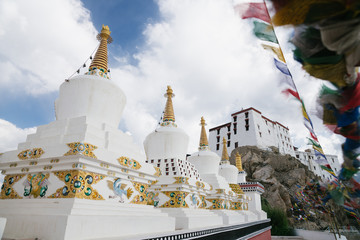 Panoramic photo from above of Tibet Buddhism monastery stupas on the mount at sun light