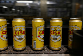 Cans of Cisk Lager are seen on a conveyor belt at the beer packaging facility at Farsons Brewery in Mriehel
