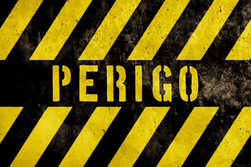 Perigo (in Portuguese language, danger) warning sign text with yellow and dark stripes painted over concrete wall facade texture background. Concept image for caution, peril and hazard.