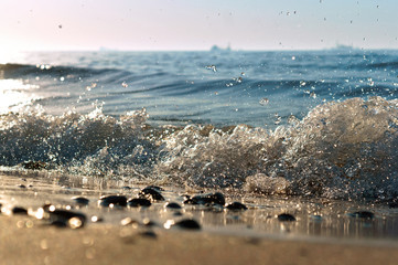 sea wave, the excitement on the shore sea, sea water foam, the water is boiling