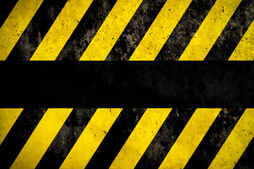 Warning background with yellow and dark stripes painted over concrete wall facade texture and empty space for text message in the middle. Concept image for caution, danger and hazard.