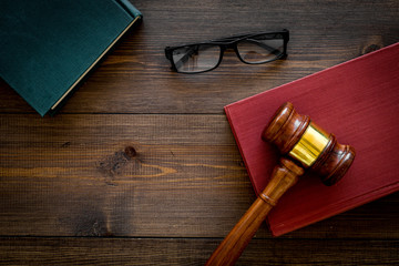 Law student concept. Judge gavel and vintage books on dark wooden background top view copy space